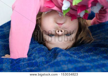 Child With Upside Down Head Looking