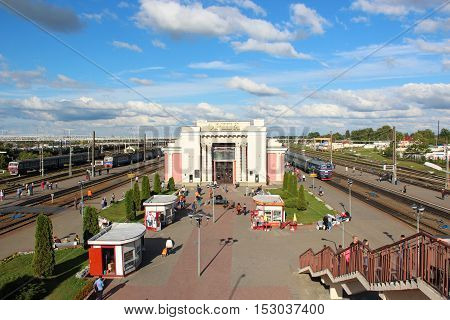 Orsha, Belorussia - Aug 18, 2016: Main building of the railway station and passengers walking along. Summer evening.