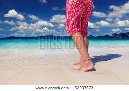 Tanned woman on the tropical beach, Andaman Sea, Thailand