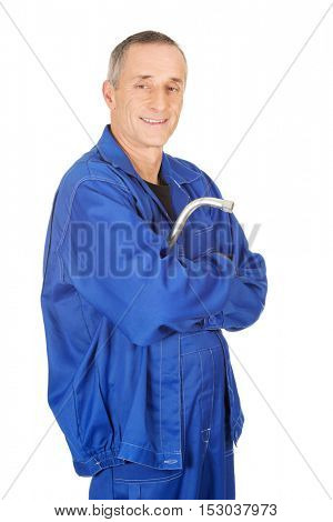 Happy repairman holding wrench