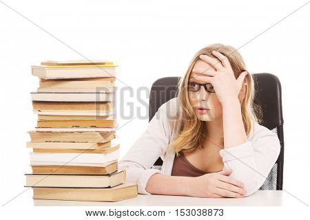 Young woman with a books pile