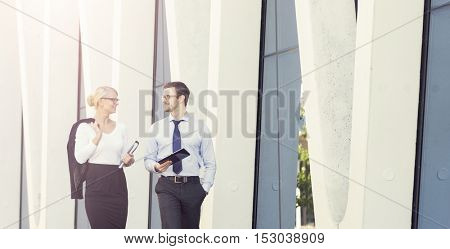Business people outdoor. Businessman and businesswoman in the street. Businesspeople concept.