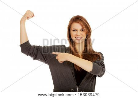 Funny woman showing her muscles