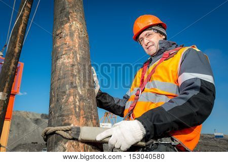 Russia - oktober, 2016: Electrician lineman repairman worker at climbing work on electric post power pole