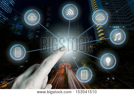 Internet of things futuristic background showing domotic connections with finger
