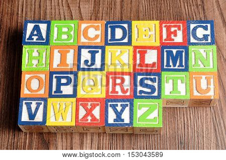 Colorful alphabet blocks A to Z displayed on a wooden background