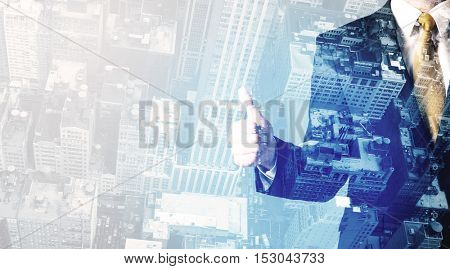 Business person standing with blue cityscape in the background