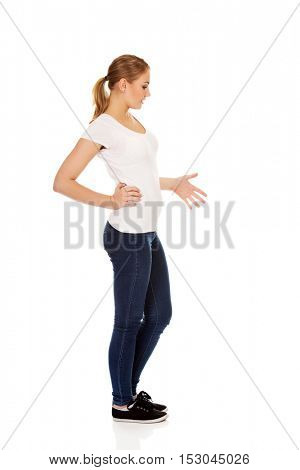 Side view of pregnant teenage woman