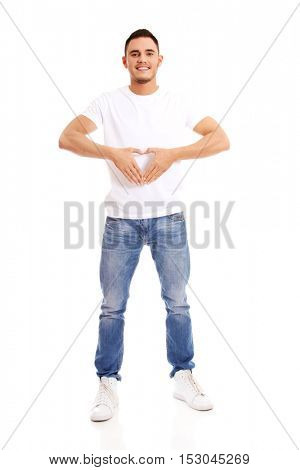 Young man doing heart gesture