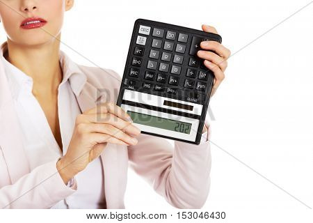 Worried business woman shows sos on calculator