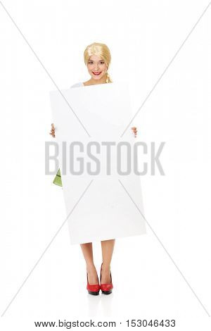 Woman wearing Bavarian dress holding empty banner.