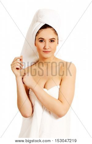 Smile beautiful woman wrapped in towel