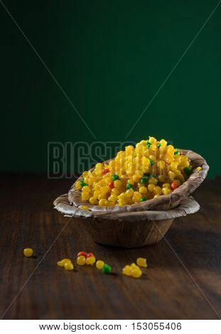 'Sweet bundi' - an Indian traditional sweet served in an eco friendly bowl. Indian stock food photography.