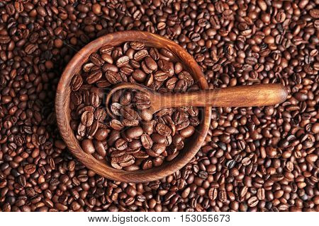 Wooden bowl with coffee beans and spoon