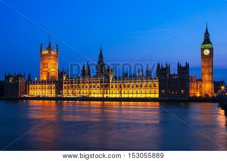 Night view of Big Ben Clock Tower and the Houses of Parliament at city of Westminster London UK