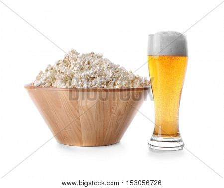 Beer with popcorn on white background