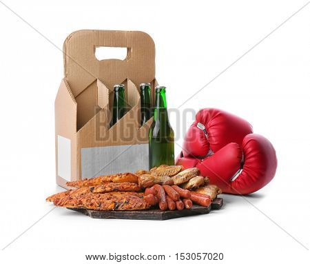 Beer with snacks and boxing gloves on white background