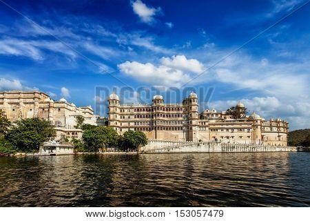 India luxury tourism concept background - Udaipur City Palace from Lake Pichola. Udaipur, Rajasthan, India