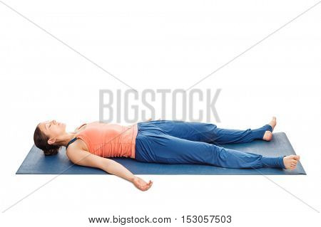 Yoga relaxation - beautiful sporty fit woman relaxes in yoga asana Savasana - corpse pose isolated on white