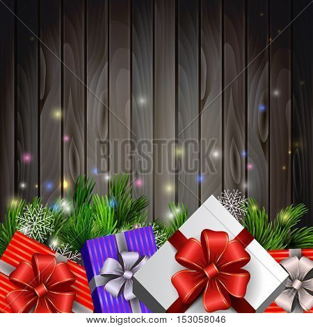 Holiday Christmas background with gift boxes and christmas tree brunches on wooden background. Vector.