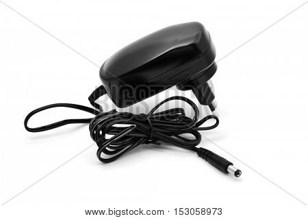an AC adapter on a white background