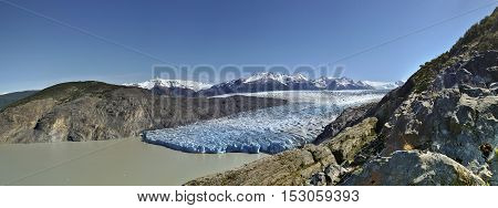 Gigantic glacier panorama under the blue sunny sky, Torres del Paine, Chile