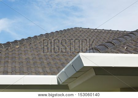 Gutter On Roof Top Residential Building House