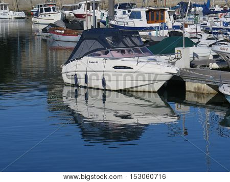 Boat Reflecting In Harbour