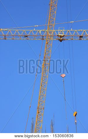 abstract image part of arm machinery construction crane with blue sky background