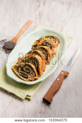 strudel stuffed with ham  spinach and poppy seeds