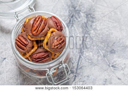 Chocolate Caramel Pecan Pretzel Bites in a jar