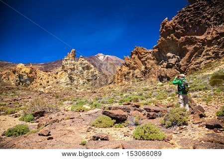 tourist man taking picture at the Teide National Park Tenerife Canary Islands Spain