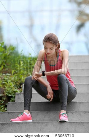 Young woman resting after run on stairs