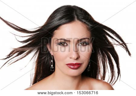Portrait of beautiful woman with trendy makeup on white background