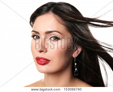 Portrait of young beautiful woman with red lips on white background