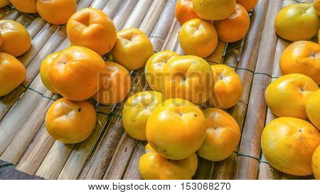the oranges in grouping on bamboo table in market street.