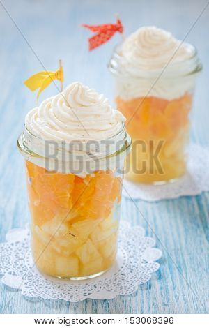 Fruit dessert with vanilla cream look like a candy corn