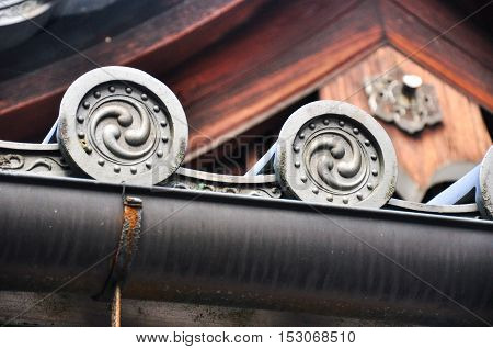 the tradition japan architecture detail of wood and ceramic roof. with iconic symbol asia style.