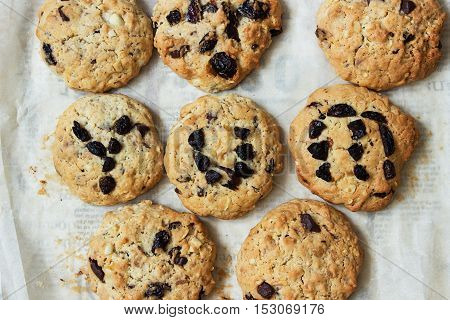 the word yum spelt out on cookie on newspaper background