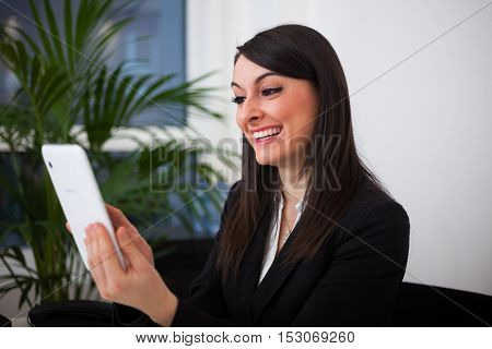 Businesswoman using a digital tablet in her office
