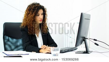 Businesswoman using a laptop in her office