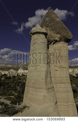 Prehistoric rock formations in front of Love valley in Turkey shot during cloudy day