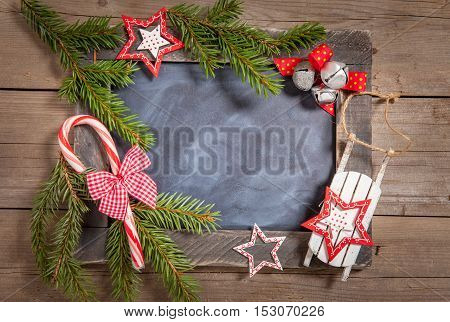 Christmas decoration with rustic chalkboard and stars