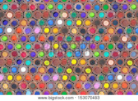 Seamless texture background. A lot of bright of colorful wooden pencils for drawing.