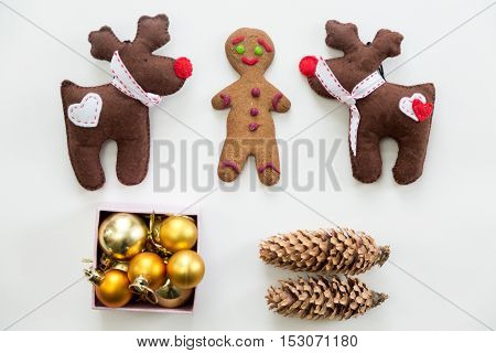 Flat view of cute Christmas decoration, cones, box of glass balls, ginger man, Rudolph the Red Nosed Reindeer toys. Christmas concept, high angle