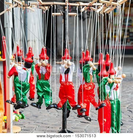 Traditional Italian toys. Wooden pinocchio puppet as a souvenir of Italy