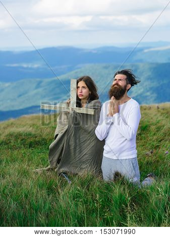 Couple Pray On Meadow