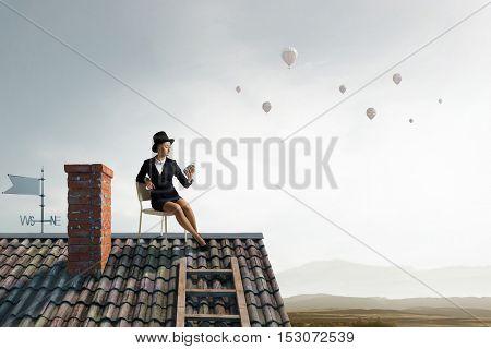 Elegant businesswoman in cylinder hat . Mixed media