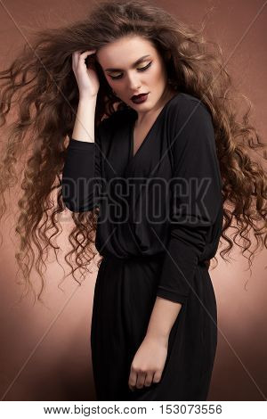 Sensual Woman With Blowing Hairstyle And Professional Makeup