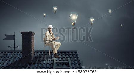 Elegant businessman in cylinder hat . Mixed media